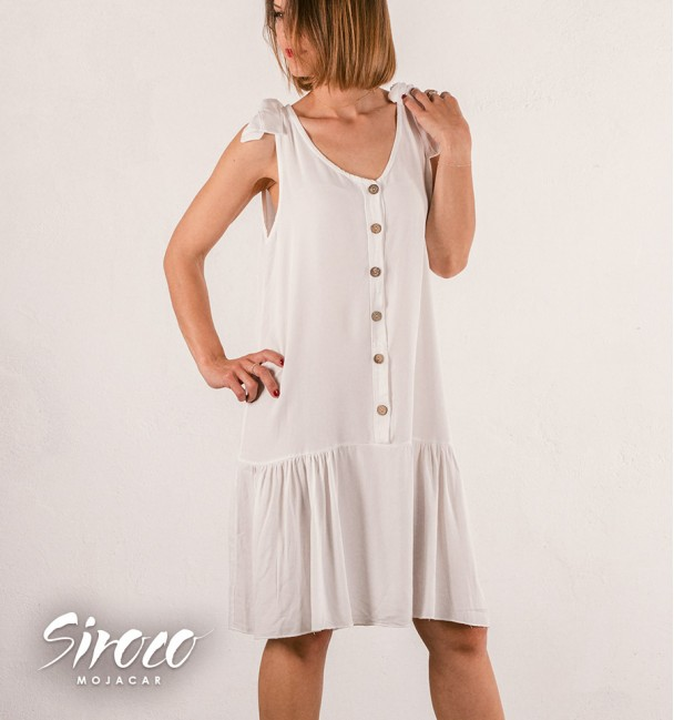 white dress with pleated skirt and buttons