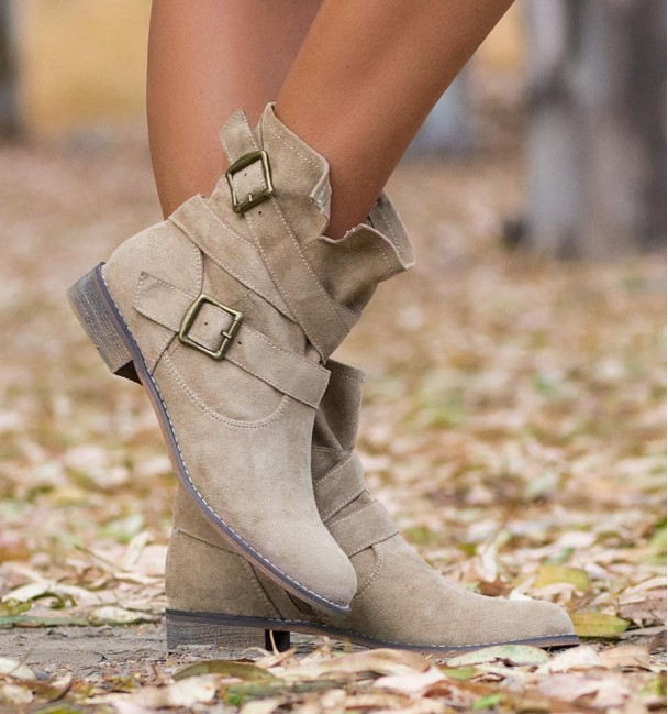 beige cowboy boots with low heel and buckles