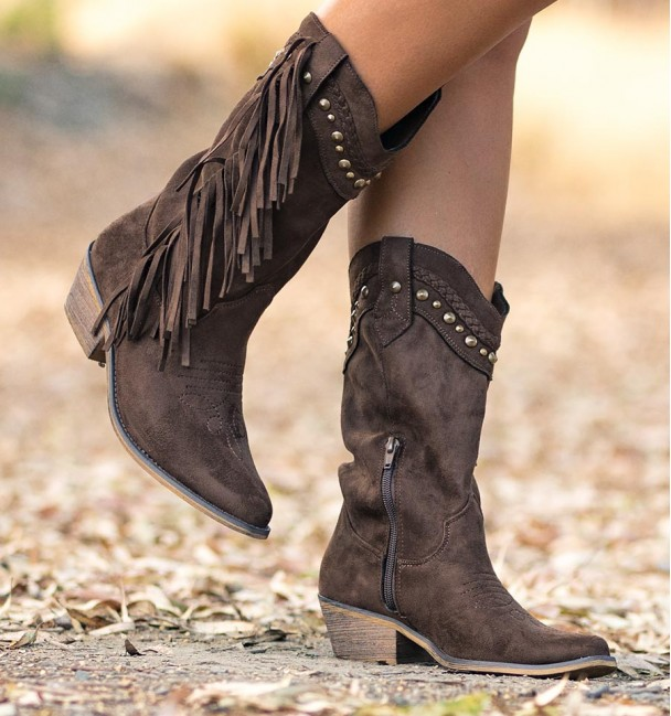 Brown cowboy boots with fringes and studs